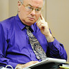 Globe/T. Rob Brown<br /> Joplin East Middle School English teacher Randy Turner looks over notes during his hearing at Joplin School District's administration offices Thursday morning, May 23, 2013.