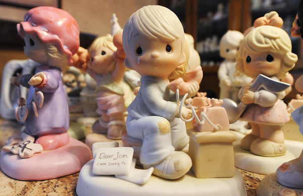 """Globe/T. Rob Brown<br /> A Precious Moments figurine, part of an extensive collection, Wednesday morning, May 8, 2013, at a home in Granby. This particular piece """"Dear Jon"""" bears the name of the Granby woman's son so she hand many copies of it."""
