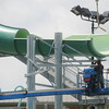 Globe/Roger Nomer<br /> A large portion of a water slide is attatched as progress continues at the Schifferdecker Pool on Friday afternoon.
