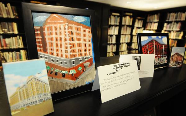 Globe/T. Rob Brown<br /> Local young artists have their work on display in the Post Memorial Art Reference Library in the Joplin Public Library Wednesday afternoon, May 1, 2013. The students are part of Local Color located in the Gryphon Building and have created art of historic local buildings and landmarks, such as this work of the Connor Hotel by Bentley Allen, 9.