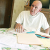 Globe/Roger Nomer<br /> Harold Barr talks about documentation of his fraud case during an interview on Wednesday.
