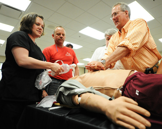 Globe/T. Rob Brown<br /> Southwest Missouri medical and emergency personnel train with a sophisticated dummy Wednesday afternoon, May 15, 2013, at the Freeman Business Center in Joplin. From left, Missy Stamate, Freeman Health System R.N. from Webb City, Ed Hultgren, Ozark EMT, Mike Behringer, Bates County Memorial Hospital respiratory therapist, and Paul Harris, Luke Regional Hospital emergency preparedness resource and R.N., participate in a weapons of mass destruction emergency scenario.