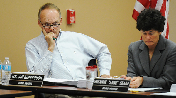 """Globe/T. Rob Brown<br /> Joplin School District Board of Education members Jim Kimbrough (left) and Anne Sharp listen as sexually explicit scenes are read from Randy Turner's book, """"No Child Left Alive"""" during Turner's hearing at Joplin School District's administration offices Thursday morning, May 23, 2013."""