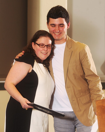 Globe/Roger Nomer<br /> Clayton Woolery, from Thomas Jefferson Independent Day School, gets a hug from his teacher Zina Lewis during Monday's 2013 All-Area Academic Excellence Team banquet at Missouri Southern.
