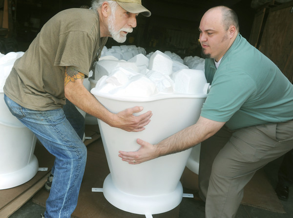 Globe/Roger Nomer<br /> David Hightower, left, and BJ Harris, director of the Pittsburg Convention and Visitors Bureau, lift a coal bucket for transport on Thursday.