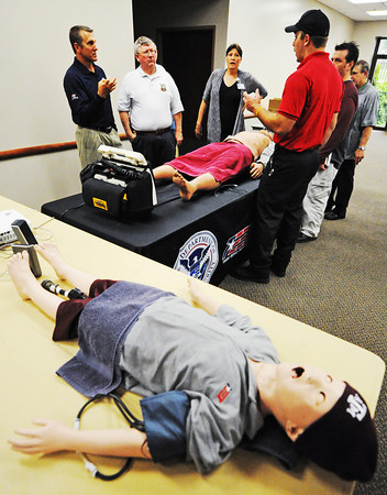 Globe/T. Rob Brown<br /> Jeff Case, left, TEEX (Texas Engineering Extension Services) instructor for EMS response to weapons of mass destruction, trains a group of Southwest Missouri medical and emergency personnel Wednesday afternoon, May 15, 2013, at the Freeman Business Center in Joplin. The training uses sophisticated dummies to simulate medical response scenarios.