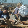 Globe/Roger Nomer<br /> Mindy Geist, left, and Charlotte Laughlin unload an armful of meals for volunteers near Telephone Road in Moore Okla., on Wednesday afternoon.  The duo was volunteering with the Church of the Harvest.