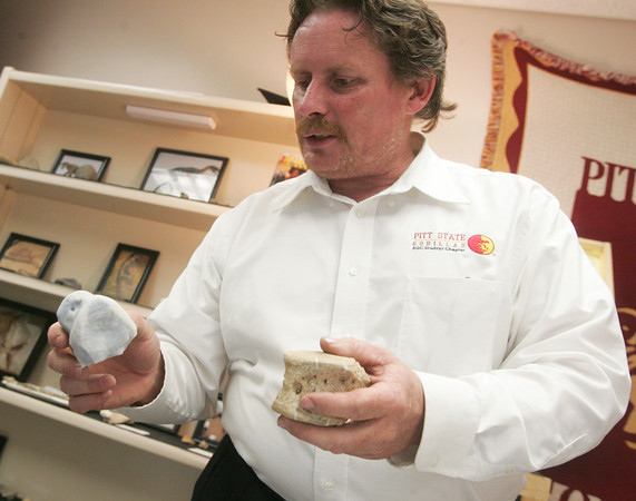Globe/Roger Nomer<br /> Sean McCartney, a Pittsburg State senior, talks about a vertebrae bone, the original in his left hand and the model created with a 3D printer in his right.
