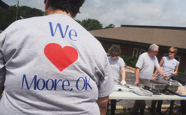 Globe/Roger Nomer<br /> T-shirts worn by staff at the Probation and Parole Office show their support for Moore, Okla., during Friday's fundraiser.