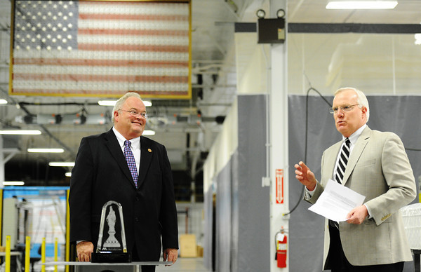 Globe/T. Rob Brown<br /> Karl G. Glassman, president and COO of Leggett & Platt Incorporated, right, announces the presentation of the NAM (National Association of Manufacturers) Award for Manufacturing Legislative Excellence to Congressman Billy Long Thursday afternoon, May 2, 2013, at the Carthage industry's Idea Center. According to NAM, Long tallied a perfect 100-percent voting record on key manufacturing issues during his first term in the House.
