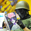 "Globe/T. Rob Brown<br /> Wyatt Bruner of Joplin, dressed as a military man in an actual 1970s military helmet and some of his grandfather's old military uniform, reads an issue of the ""My Little Pony"" comic book during the Free Comic Book Day national event at Hurleys Heroes comic book and games store on Main Street in downtown Joplin. Bruner is also a member of the Joplin High School Cartoonist Club. Store owner Justin Hurley said the turnout was better than expected and local comic book artists, such as Jeremy Haun and the Cartoonist Club were on hand to sign autographs and create custom pieces for fans."
