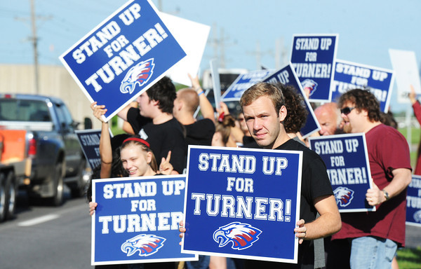 Globe/T. Rob Brown<br /> Jerad Fisher (right), 19, of Joplin, a Joplin High School graduate, and other protestors hold up signs in support of Joplin East Middle School teacher Randy Turner just before Turner's hearing at Joplin School District's administration offices Thursday morning, May 23, 2013.