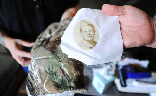 Globe/T. Rob Brown<br /> Delbert McGuirk plans to get the pictured camouflage pattern and the photograph of his father in military dress added to his new artificial leg soon, while in his temporary Carl Junction home Friday, May 17, 2013.