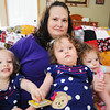 Globe/T. Rob Brown<br /> Jayme Harper holds her triplets (from left) Reagan, Addison and Lauren Thursday afternoon, May 16, 2013, in their Joplin home. The triplets who were born May 17, 2011, less than a week before the tornado, turn 2 today.