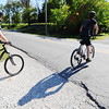 Globe/T. Rob Brown<br /> Bicyclists cast their shadows as they traverse the Frisco Trail, as they cross St. Louis, in the Royal Heights area Saturday afternoon, May 13, 2013.