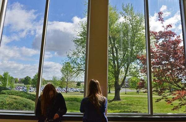 Globe/Roger Nomer<br /> Cassie Redmon, a Missouri Southern senior from Joplin, left, waits for her friend Ashton Yust, a junior from Joplin, to vote in Wednesday's election at the Billingsly Student Center.