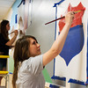 Globe/Roger Nomer<br /> Recent Joplin High graduates Ashley Taylor, left, and Rebekah Walters work on a mural at Northpark Mall on Wednesday morning. The mural, designed and created by Joplin students, will depict a timeline of Joplin and landmarks of the city.