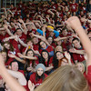 Globe/Roger Nomer<br /> Joplin senior Shelbie Dewitt leads the senior class in a roller coaster cheer on the steps of the new Joplin High School on Friday.