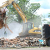 Crew remove debris from a razed house near 10th and Washington streets in Baxter Springs on Wednesday.<br /> Globe | Laurie Sisk