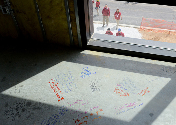 Globe/Roger Nomer<br /> Current Joplin High seniors wrote messages to future classes at the new Joplin High on Friday.