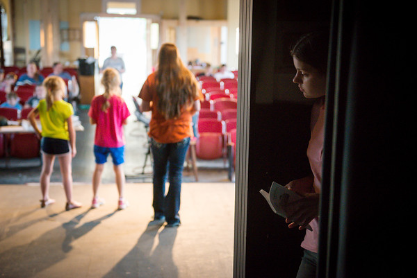 """Globe/Roger Nomer<br /> Annie Ashwell listens for direction backstage during rehearsal for """"The Adventures of Beatrix Potter and Her Friends"""" at Joplin's Stained Glass Theatre on Monday evening."""