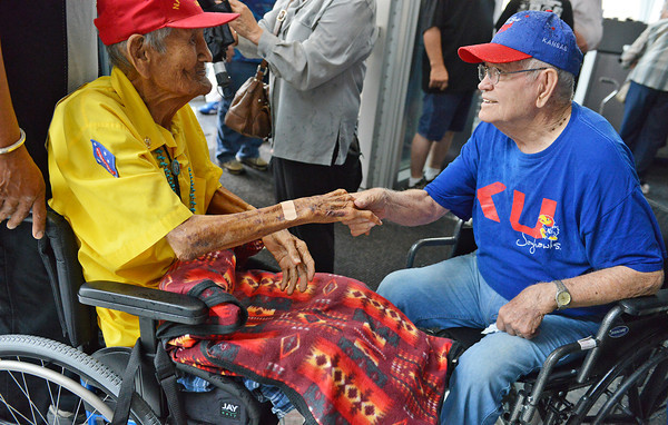 Globe/Roger Nomer<br /> World War II veteran Bill Wilson, Pittsburg, greets Chester Nez, the last remaining original Navajo code talker from WWII, during a Memorial Day event at the Pittsburg State Veterans Memorial on Monday.