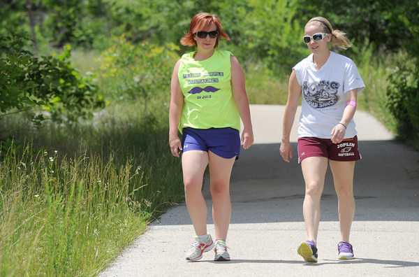 Dia Skiles, left and Whitlee Allen enjoy a walk on the wildcat Glades Trail near Reddings Mill Bridge on Thursday.<br /> Globe | Laurie Sisk