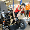 Pittsburg State automotive technology students Feras Kintab, front, and Jacob Saunders work on their Kansas baja car at the Kansas Technology Center Thursday in preparation for next weekend's event at PSU.<br /> Globe | Laurie Sisk