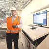 Mercy Hospital project manager John Farnen explains how installation of computers with construction information located throughout the hospital have aided in building the facility.<br /> Globe | Laurie Sisk