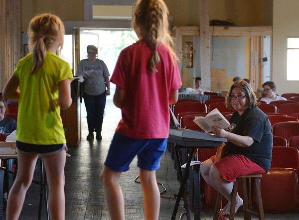 "Globe/Roger Nomer<br /> Jill Spencer gives music direction to and Alli Rauch, 8, and Sierra Hicks, 7, during rehearsal for ""The Adventures of Beatrix Potter and Her Friends"" at Joplin's Stained Glass Theatre on Monday evening."