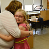 Globe/Roger Nomer<br /> McCune special education teacher Jenny Lynch gives a hug to Hanna Powell, second grade, during the last day of school at McCune Elementary.