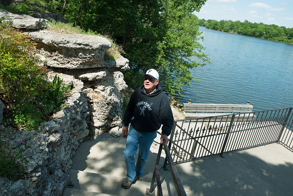 Globe/Roger Nomer<br /> Bob Forest walks along his lake-front property at Crawford State Park on Thursday.