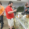 SWMO Vape Shop owner Bradley Crane, right assists customers Josh Kruse, left and Matt Graham, both of Pittsburg on Friday at his shop. Crane said the new list of FDA regulations is more than 200 pages.<br /> Globe | Laurie Sisk