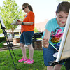 Globe/Roger Nomer<br /> Abbie Golden, 8, paints a scene in Spiva Park with her mother Aimee, Joplin, during Saturday's Mommy and Me Plein Air Paint Day with the Spiva Center for the Arts.