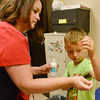 Globe/Roger Nomer<br /> Stacey Whitney treats Shawn Suarez, kindergarten, for poison ivy at Carl Junction Elementary School on Thursday.