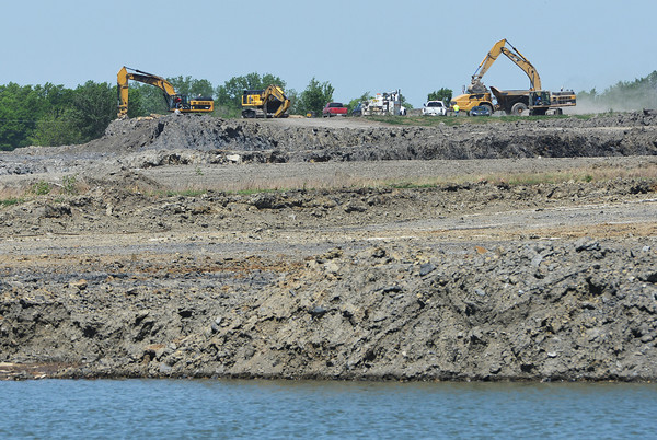 Globe/Roger Nomer<br /> Construction continues on a mined wildlife area near West Mineral.