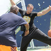 DeMarco Clark, right tries to deflect a James Carey pass during a game of pick up basketball on Friday at Cunningham Park.<br /> Globe | Laurie Sisk