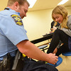 Globe/Roger Nomer<br /> Crawford County Sheriff's Deputy and School Resource Officer Dallas Pulliam ties Kalei Campbell's, second grade, shoe during lunch at McCune Elementary.