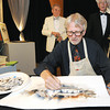 Local artist Jin Bray demonstrates his mastery of watercolors with a demonstration at Downstream Casino during the 52nd Annual St. Avips Ball to benefit the George A. Spiva Center for the Arts on Friday.<br /> Globe | Laurie Sisk