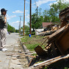 Globe/Roger Nomer<br /> Jim Leyba pauses to look over tornado damage while searching for lost photos in Baxter Springs on Friday.