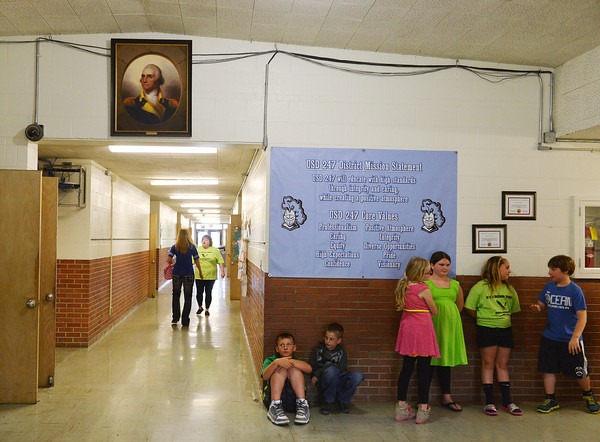 Globe/Roger Nomer<br /> Towards the end of the school day, students line up for the last time in the hallway at McCune Elementary on Tuesday.