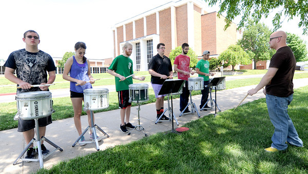 Members of the Missouri Southern State University drumline practice Sunday afternoon on the MSSU campus.<br /> Globe | Laurie Sisk