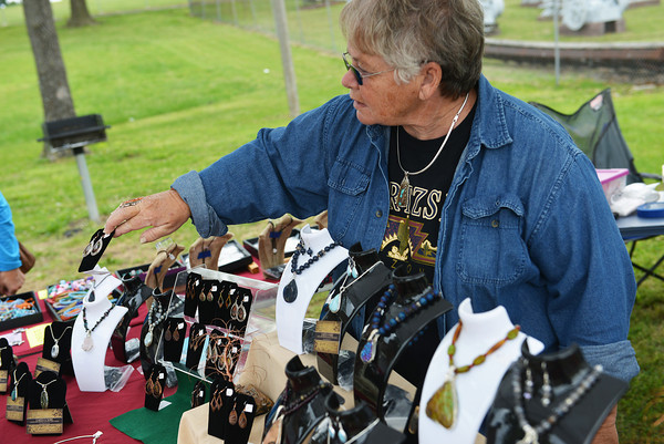 Globe/Roger Nomer<br /> Jan Porter, Sparta, displays her jewelry creations at the 8th Annual Tri-State Gem and Mineral Society Annual Spring Rock Swap on Friday. The gem show continues through Sunday at Schifferdecker Park.