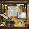 Globe/Roger Nomer<br /> Momentoes from the history of McCune Elementary are arranged in a display case at the school.