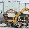 Globe/Roger Nomer<br /> Demolition continues at the former Fruit Company building in Joplin on Monday.