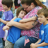 "Globe/Roger Nomer<br /> During a rendition of ""Amazing Grace,"" Rebecca Hutchinson, Miami, hugs her son Avian, 5, while attending a Memorial Day ceremony at the Grand Army of the Republic Cemetery in Miami, also with her other son Azrial, 7. Hutchinson's father is a Vietnam veteran."