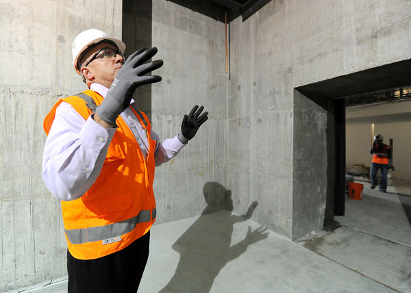 Mercy Hospital project manager John Farnen describes the structure of the deep-walled acceleration vaults at the new hospital during a tour of construction on Wednesday.<br /> Globe | Laurie Sisk