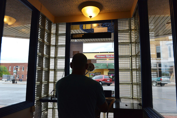 Globe/Roger Nomer<br /> A view from the Route 66 Theater ticket booth shows part of the proposed historic district downtown as Travis Shaw sells tickets on Thursday afternoon.