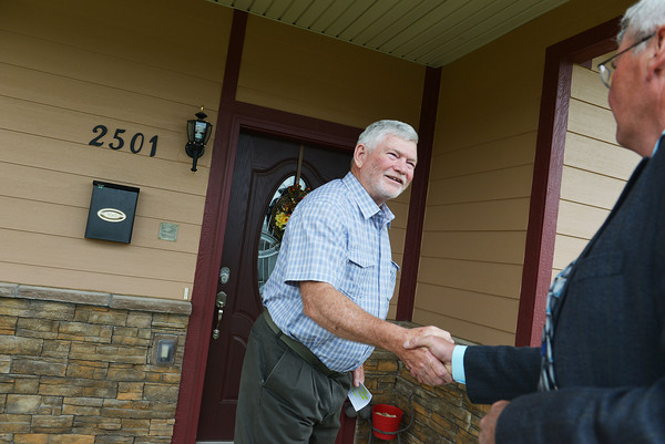 Globe/Roger Nomer<br /> Hugh Shields welcomes Greensburg Mayor Bob Dixson to his house for a tour on Monday. Shields rebuilt his house with many energy-efficient and green features after the tornado.