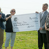 Globe/Roger Nomer<br /> (from left) Jerrod Hogan, co-founder of Rebuild Joplin, Nancy Good, Mike Gray, both board members of the Community Foundation of Southwest Missouri, and Stephanie Howard, chairman of the foundation, present a check to Rebuild Joplin on Wednesday morning.